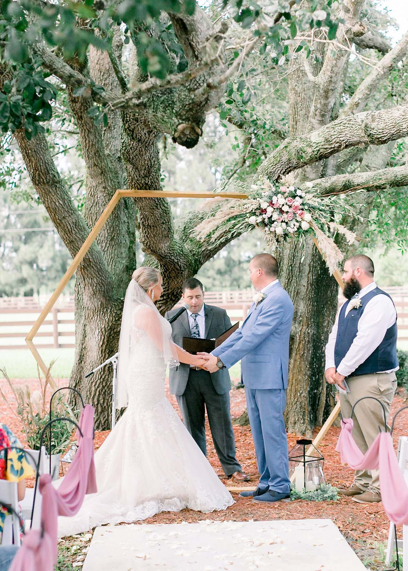 Masters Stables outdoor tree shaded wedding venue chairs-7 ceremony altar. Rustic outdoors