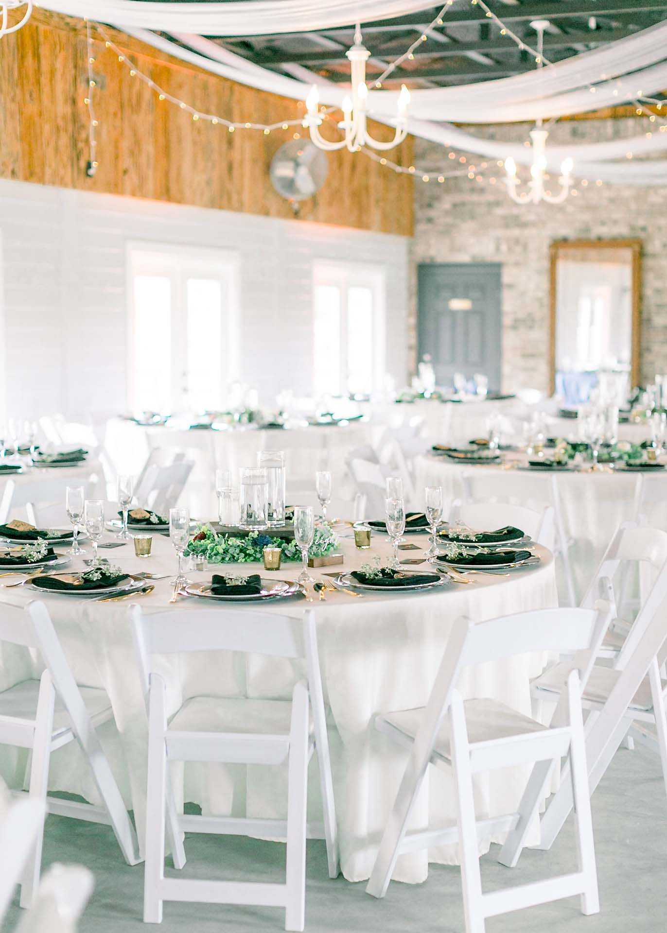 Masters Stables wedding venue air conditioned barn-3 hanging lights tables