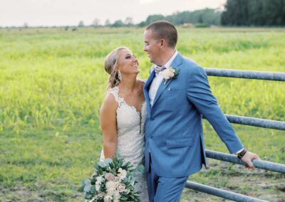 Masters Stables wedding venue barn ranch-2. Bride and groom rustic field